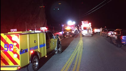 Crews responded to a head-on crash that trapped two people inside their vehicles Wednesday night on Pacific Coast Highway near Thornhill Broome State Beach.
