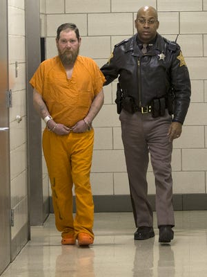Gary Thompson, the fourth Richmond Hill suspect, is escorted to his initial hearing at the City-County Building, Jan. 30, 2015.