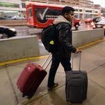 Travelers head into the terminal at Philadelphia International Airport on Nov. 26, 2014.