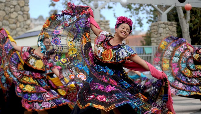 Lidia Rosales dances with the Ballet Folklorico Mestizo of Oxnard College during a Dia de los Muertos celebration two years ago.