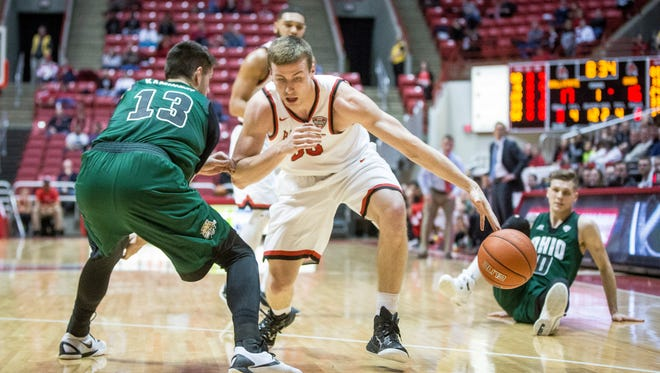 Ball State's Ryan Weber attempts to bypass Ohio's defense during the game Tuesday evening at Worthen Arena. Ball State would lose the game 72-69.