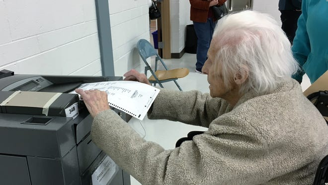 Helen Nixon, 99 of Livonia, casts her ballot Tuesday at Grant Elementary School. She said she's voted in-person in every election since she turned 18.