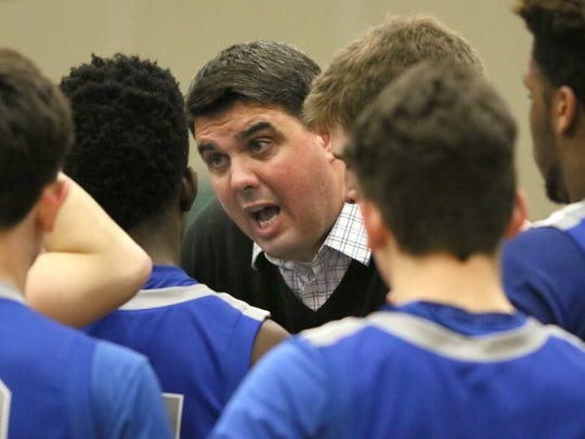Olympic boys basketball coach Devin Huff had a record of 156-104 during 11 seasons with the Trojans.