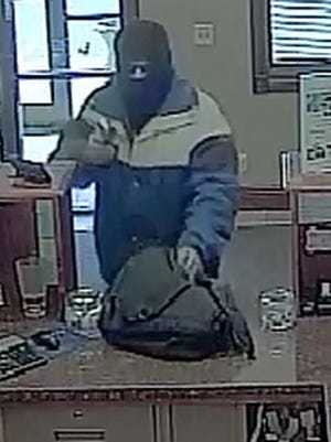 Surveillance footage shows the robber at Dacotah Bank, 3302 E. 10th St., Thursday.