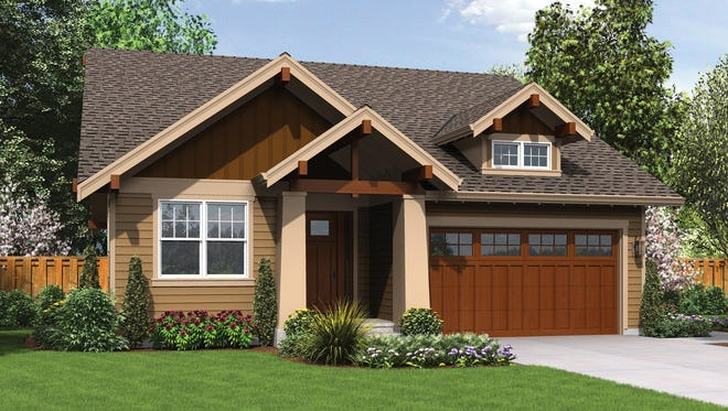 Craftsman-style columns highlight the entrance of this one-story home.