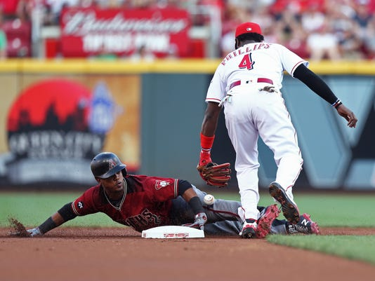 Arizona Diamondbacks' Jean Segura steals second base as Cincinnati Reds second baseman Brandon Phillips is unable to control the ball during the first inning of a baseball game, Saturday, July 23, 2016, in Cincinnati. (AP Photo/Aaron Doster)