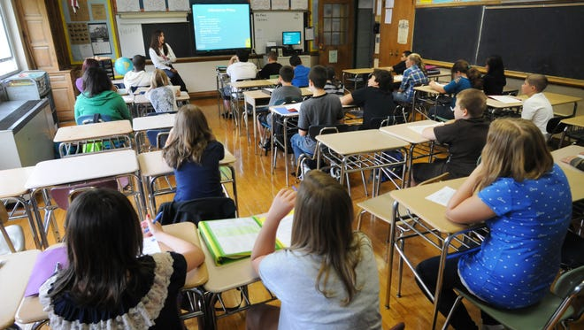 In this file photo, Wappingers Junior High School social studies teacher Tina Phelan speaks to her class the Town of Wappinger.