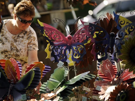 Customers peruse the many garden ornaments for sale