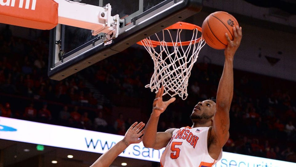 Clemson's Jaron Blossomgame goes up for two of his