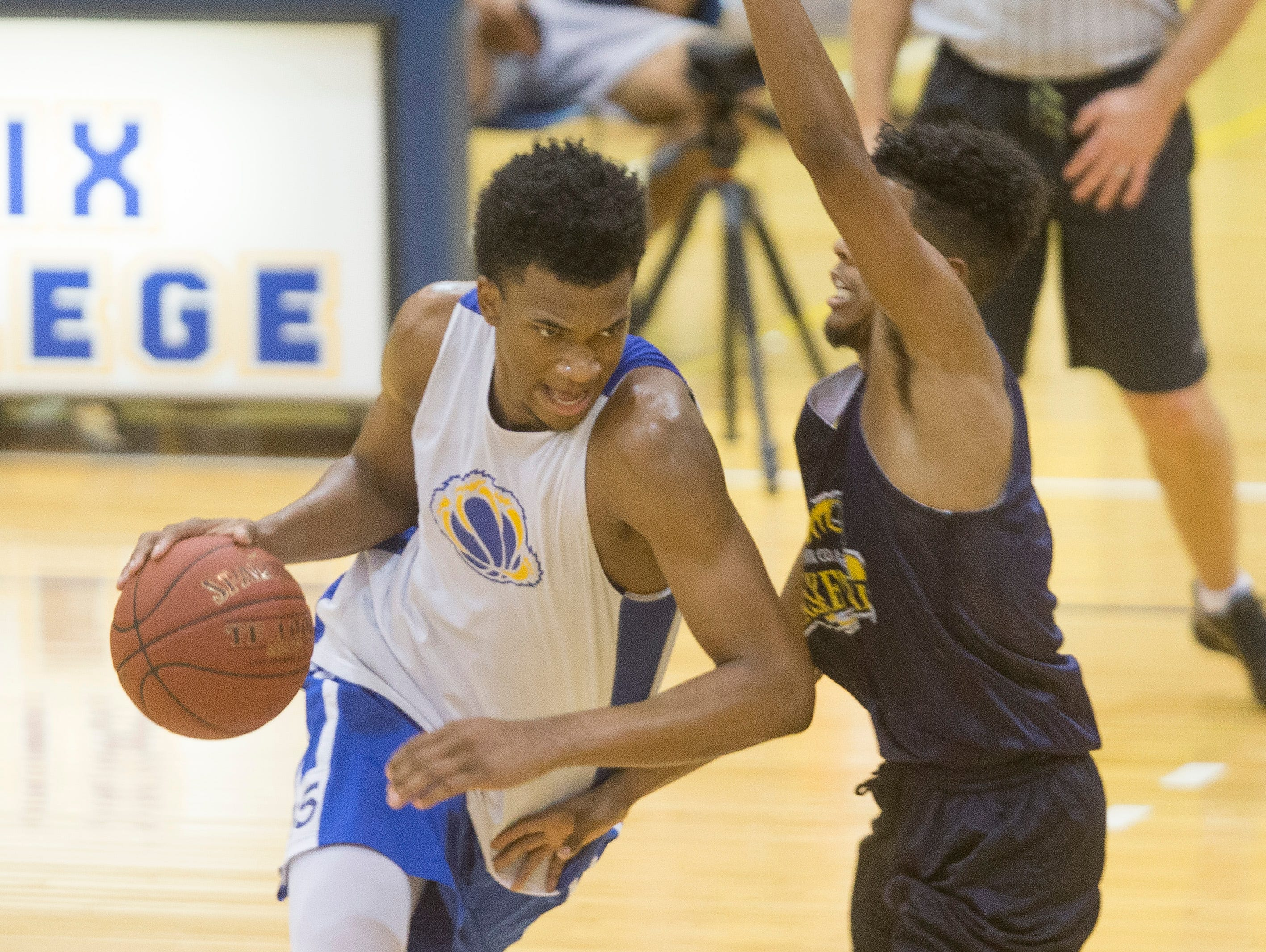 Hillcrest Prep's Marvin Bagley III drives into the lane during an exhibition game against Phoenix Community College at Phoenix Community College in Phoenix, AZ on October 8, 2015.