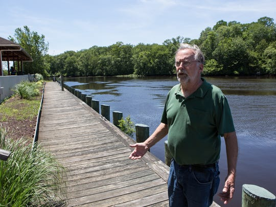 Snow Hill consultant, Michael Day, stands on a dock along the Pocomoke River on Friday, June 10, 2016.