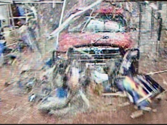 Surveillance footage of a vehicle smashing through