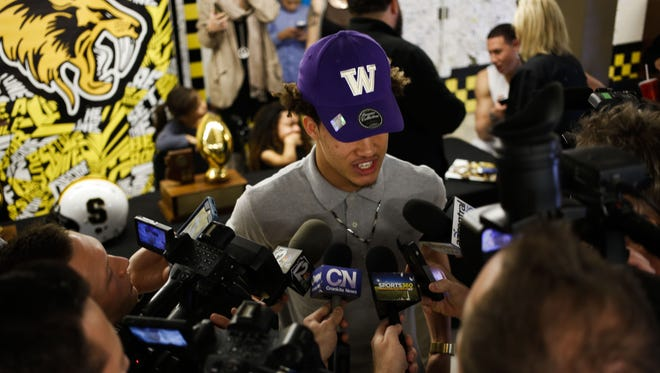 Byron Murphy, wide receiver and cornerback at Saguaro High School, talks to members of the media after making his official college decision with the University of Washington on Thursday, Jan. 21, 2016, at Saguaro High School in Scottsdale, Ariz.