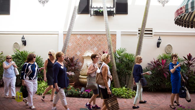 Members of the Naples Newcomers Club North make their way into Bramble's English Tea room on Wednesday, Oct. 26, 2016, in downtown Naples as a part of the Naples Chocolate Stroll. Participants visited eight shops along Fifth Avenue for chocolate treats.