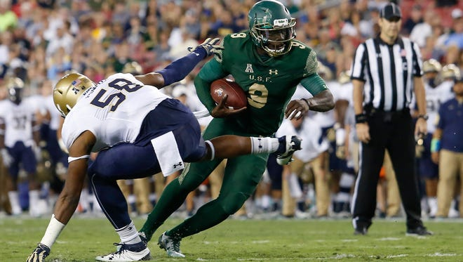 South Florida Bulls quarterback Quinton Flowers (9) runs the ball as Navy earlier this season. Flowers is South Florida's leading passer (2,551 yards, 22 touchdowns, 63.1 percent completion percentage) and rusher (1,425 yards, 15 touchdowns).