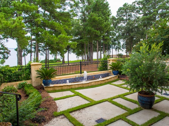 Homeowner Mike Newman had an intricate drainage system installed to accommodate the concrete and grass courtyard area.