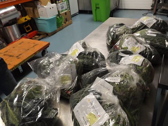 Fresh greens prepared for members of the Allen Neighborhood Center Community Supported Agriculture program.