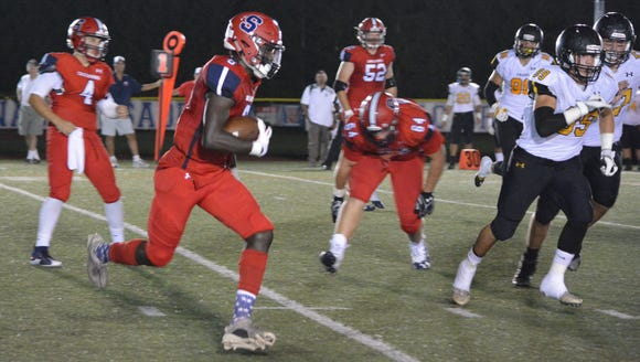 Stepinac's Trill Williams (6) takes a pitch from quarterback