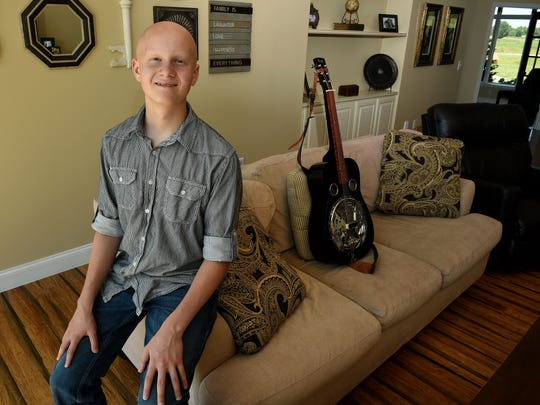 Duncan Stitt, a 13-year-old dobro-player  recently became the youngest person to win an award at Colorado's RockyGrass festival, in his home in East Knox County Tuesday, Aug. 29, 2017.