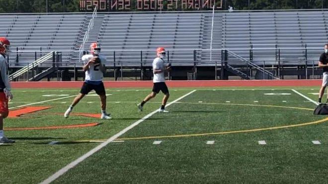 Harbor Creek quarterback Casey Smith looks to pass in practice last week.