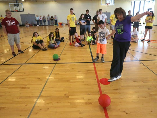 Melissa Clarke-Wharff demonstrates a game as she holds