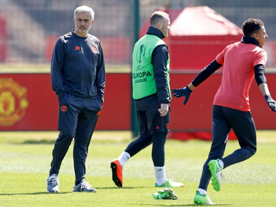 Manchester United's  manager Jose Mourinho watches over his team's training session at the team's training complex in Manchester,  England Wednesday May 10, 2017. United will play against Celta Vigo in a Europa League semifinal second leg soccer match on Thursday.  (Martin Rickett//PA via AP)