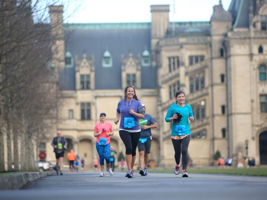 Runners pass by the Biltmore House during the 2015 Asheville Marathon and Half-Marathon, held on the grounds of the Biltmore Estate. The fourth annual race is March 12 and 13.