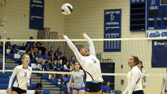 Delicia Ortega of the Lady Colts tries to set this ball backwards during action against Clint on Tuesday night.