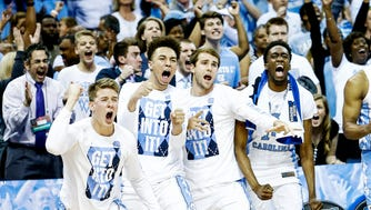 University of North Carolina celebrates a made basket against University of Kentucky during second half action of their NCAA tournament Elite Eight matchup at the FedExForum.