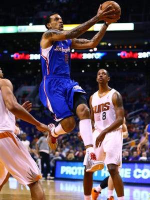 Los Angeles Clippers forward Matt Barnes drives to the basket in the first quarter against the Phoenix Suns at the US Airways Center.