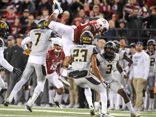 Washington State running back Jamal Morrow (25) tries