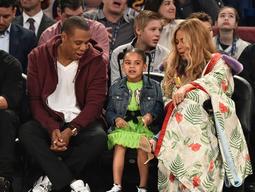 Jay Z, Blue Ivy Carter and Beyonce Knowles attend the