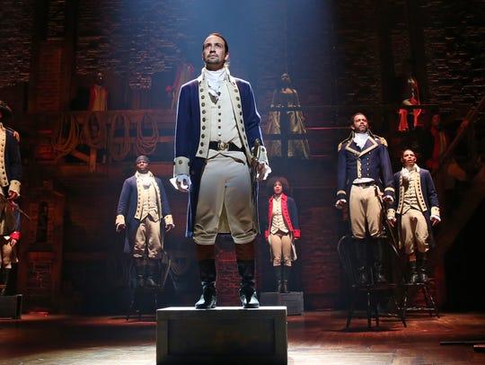 The cast of 'Hamilton' in the room where it happens.