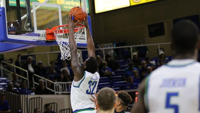 Antravious Simmons dunks during the first half against Binghamton at Alico Arena on Wednesday, Nov. 23, 2016.
