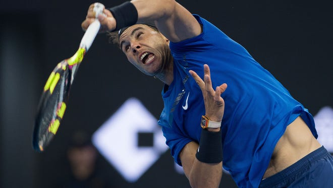 Rafael Nadal of Spain serves during his men's second round singles match against Karen Khachanov of Russia at the China Open tennis tournament in Beijing.