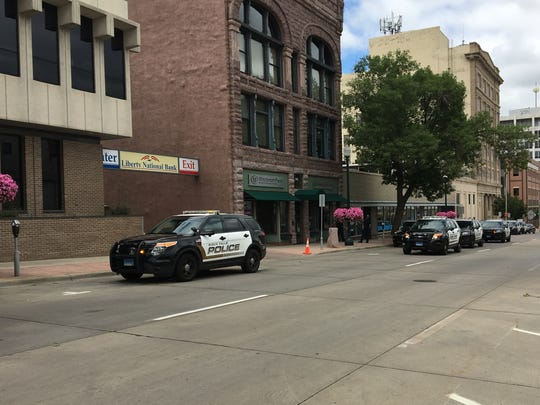 Police surround a business on Main Avenue near 10th