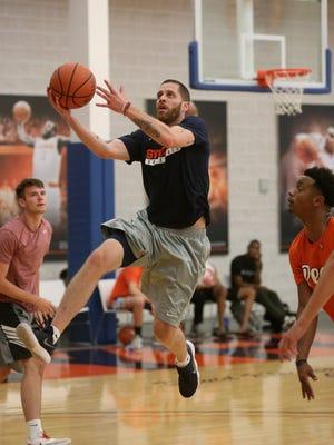 Former Syracuse player Eric Devendorf drives to the basket during a practice with the  Boeheim's Army team in The Basketball Tournament, a $2 million, winner-take-all event featuring many former college basketball players.
