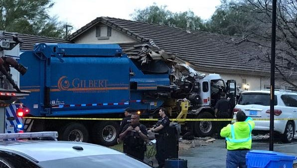 Officials say a garbage truck plowed into a home in the 3500 block of east Elgin Street early Feb. 28, 2017. The driver had minor injuries, but no one inside the home was hurt.