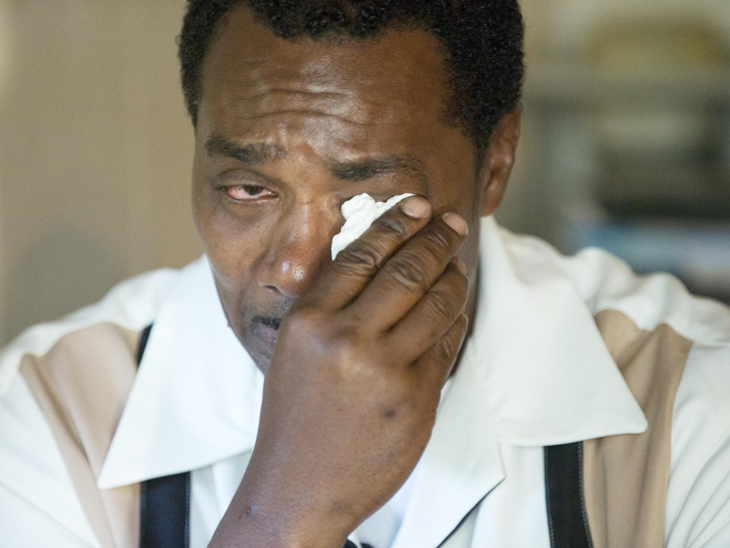 Keith Cooper, 48, cries as he recalls details of his