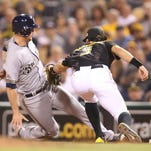 Milwaukee Brewers center fielder Logan Schafer is tagged out on a pick-off at first base by Pittsburgh Pirates first baseman Sean Rodriguez (3) during the seventh inning at PNC Park in Pittsburgh on Friday.