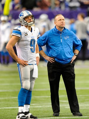 Matthew Stafford and Scott Linehan are pictured in 2013.