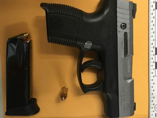 Salinas police seized a stolen, loaded 9 mm handgun from a gang member who fled on foot on Saturday.