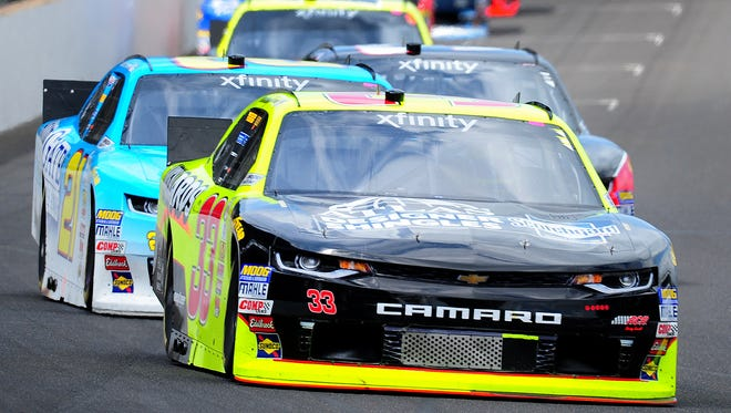 Xfinity Series driver Brandon Jones (33) leads a pack of cars into turn one during practice for the NASCAR Xfinity race Friday, July 21, 2017, afternoon at the Indianapolis Motor Speedway.
