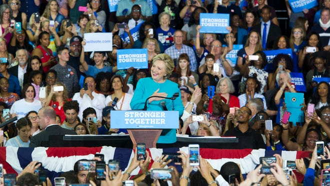 """Hillary Clinton waits as supporters sing, """"Happy Birthday"""" to her shortly after her entry to her Early Voting Rally on Wednesday, October 26, 2016 at Palm Beach State College in Lake Worth."""