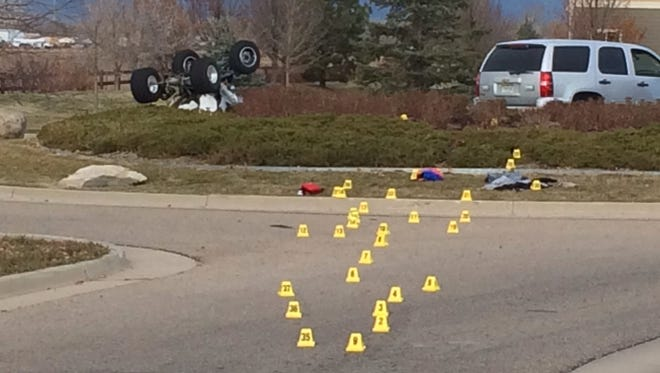 Evidence markers trace the path of an overturned ATV, left, that crashed Nov. 18, 2013 in Colorado after the driver fled police. The crash killed passenger Lindsay Davis, 26.