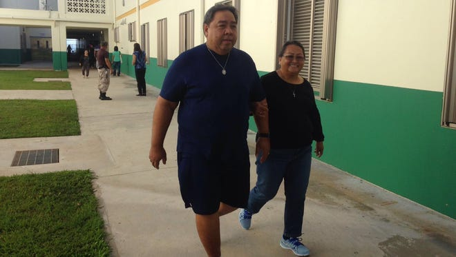 People come to JFK High School in Tamuning on Saturday, Aug. 27. The school is a polling site.