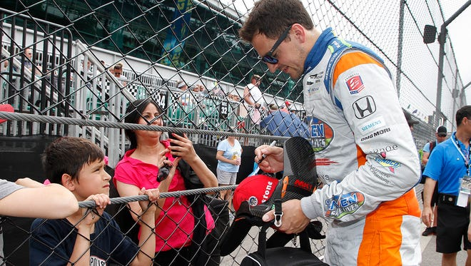 Andretti Autosport IndyCar driver Stefan Wilson (25) signs autographs for fans during Pole Day at the Indianapolis Motor Speedway on Sunday, May 20, 2018. for the Indianapolis 500.