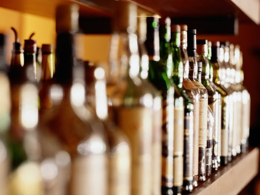 Shelf of liquor bottles (differential focus