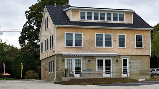 The Westport River Watershed Alliance's River Center, as seen from behind, has now reopened with limited hours.