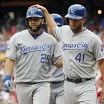 Royals' Kendrys Morales, left, is congratulated by Danny Duffy, right, after his three-run homer that scored Duffy, and Whit Merrifield on Saturday against the Philadelphia Phillies in Philadelphia.